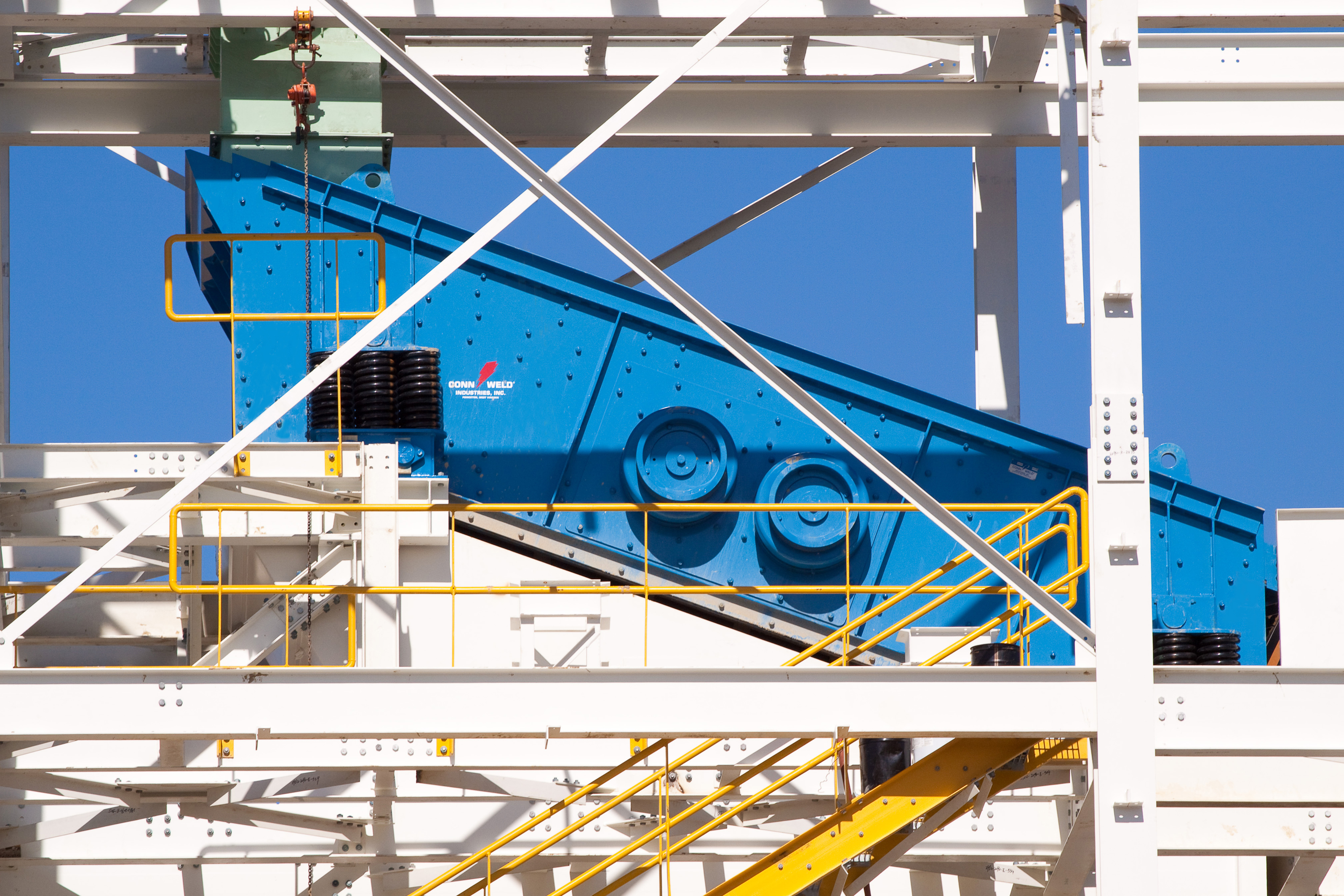 Blue Incline Vibrating Screen Installed in White Structure