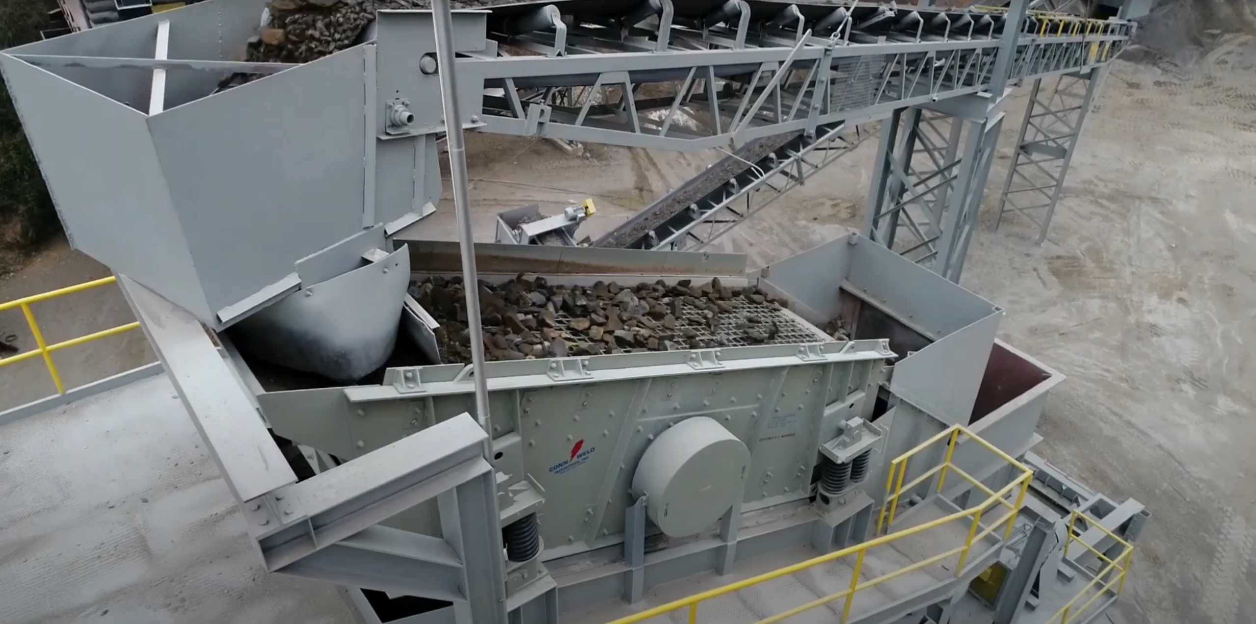 Incline screen with rock running